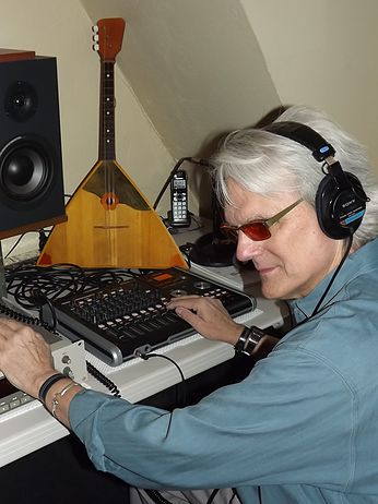 Jeff Moyer listens to a music playback with headphones in his studio